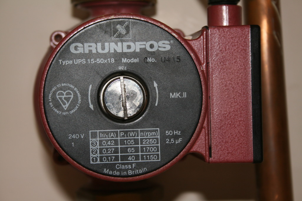 Grundfos Central Heating Pump, dark red, with black face and white writing showing three pump speeds