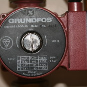 Grundfos Central Heating Pump with black face and white writing showing speed settings available.